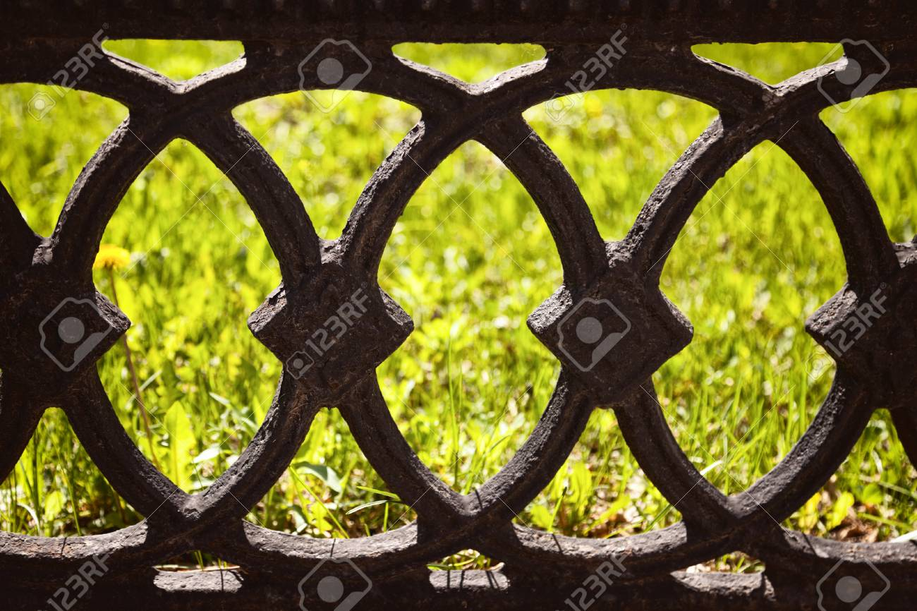 Old Black Cast Fence On A Green Lawn Background Antique Wrought
