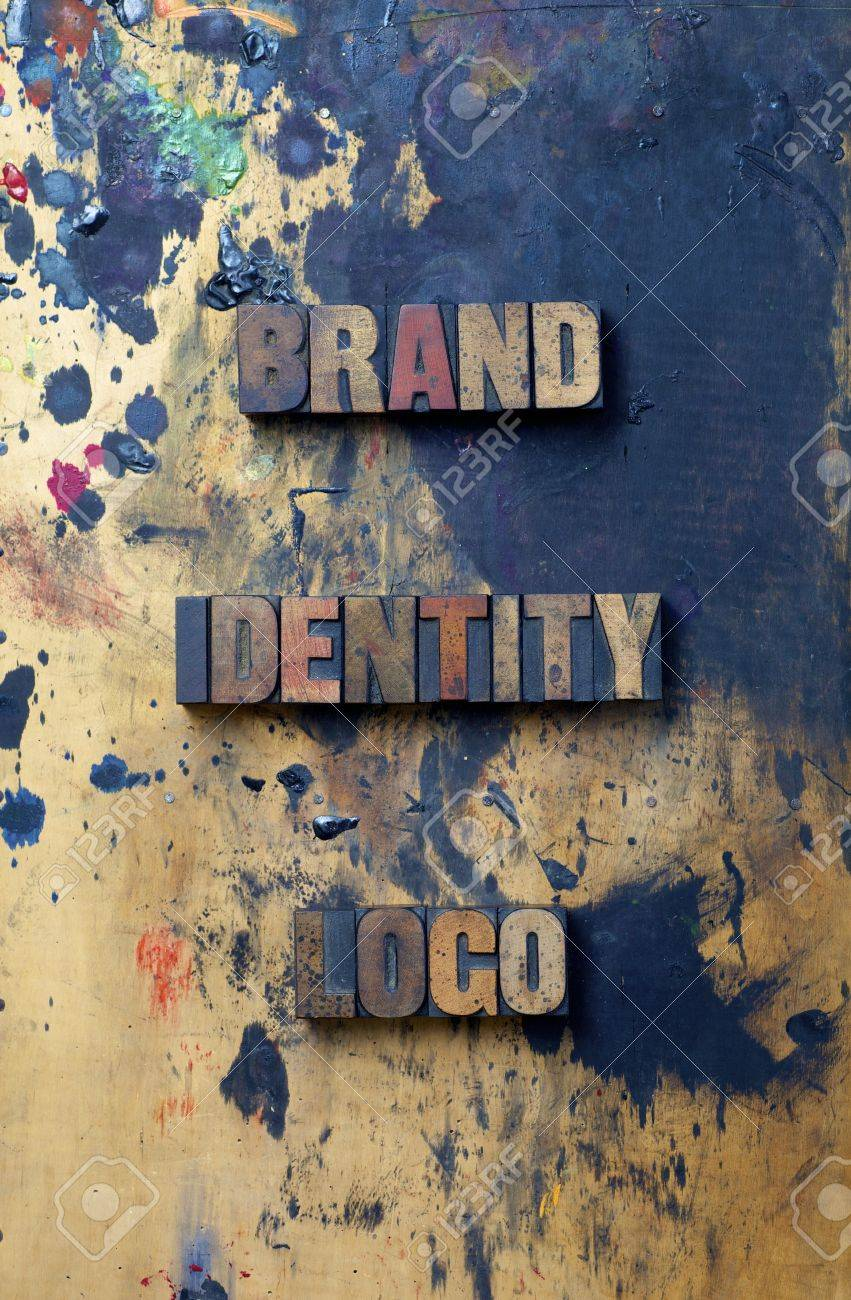 The words Brand Identity Logo written in antique letterpress printing blocks Stock Photo - 15320975