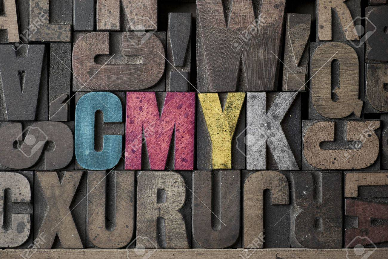 The Letters CMYK written out in very old and worn letterpress type Stock Photo - 15580116