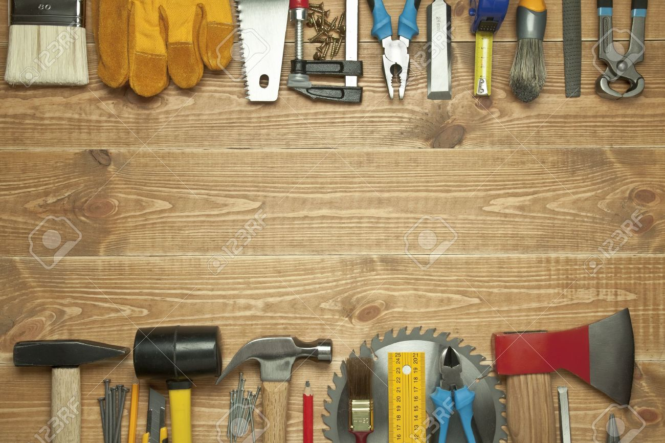 Different tools on a wooden background. - 10628538