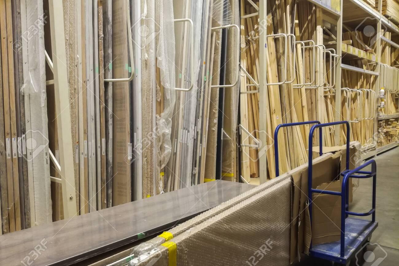 wooden bars at lumber yard of hardware store  Rack of pre-cut