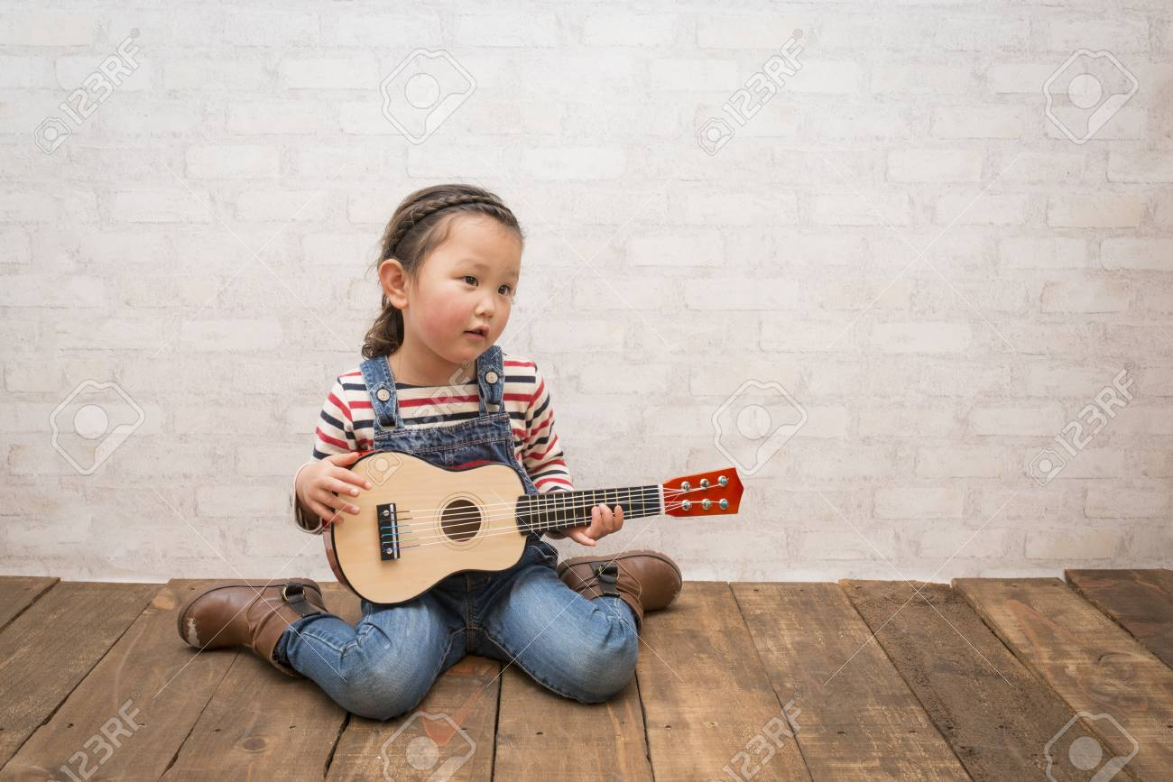 little girl plays guitar stock photo picture and royalty free image