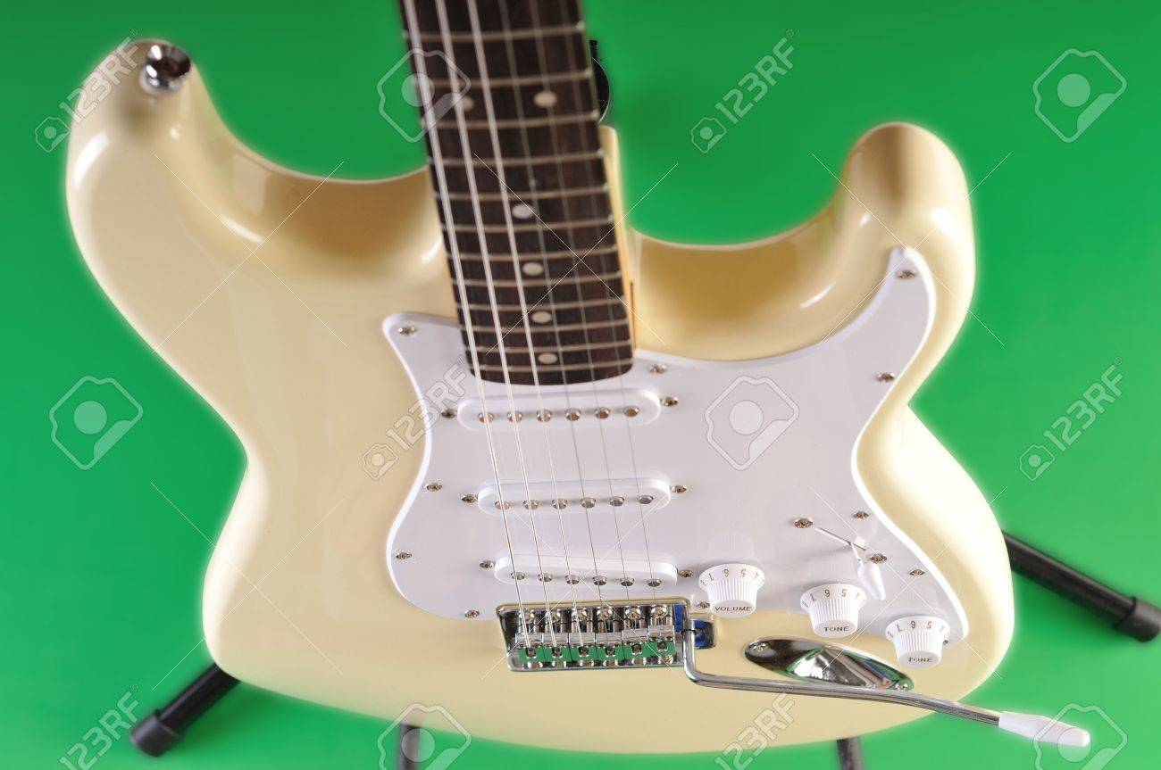A Basic Electric Guitar Set Against A Green Screen Stock Photo ...
