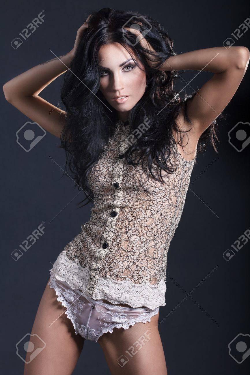 fashion portrait of a brunette girl in lacy lingerie - 18230894