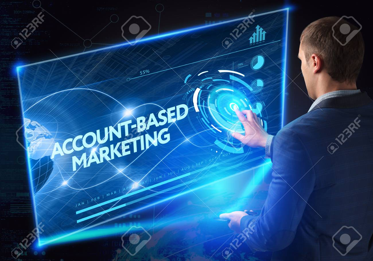 Business, Technology, Internet and network concept. Technology future. Young businessman, working on the smartphone of the future, clicks on the virtual display button: Account-based Marketing - 61500683