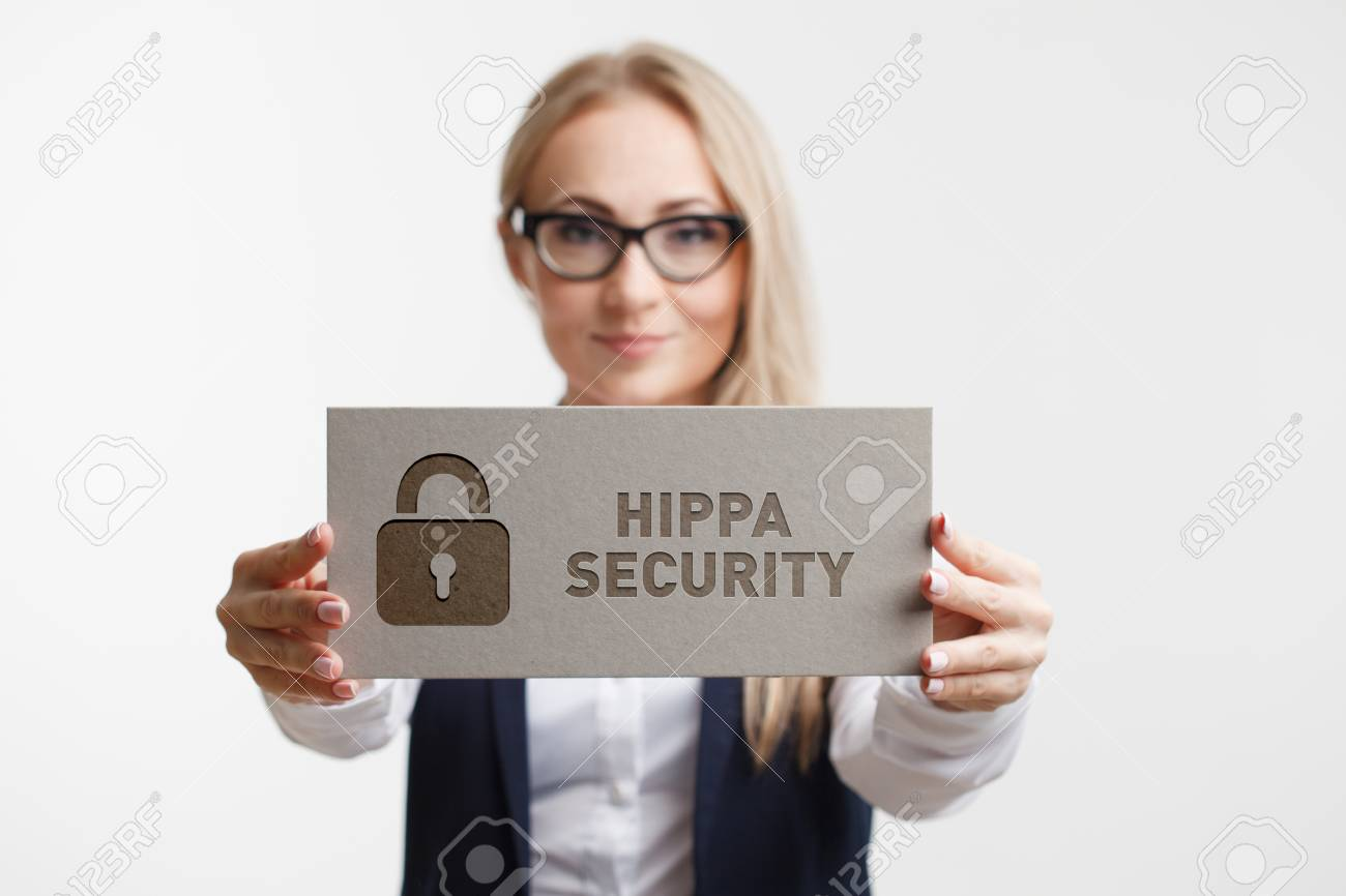 Business, Technology, Internet and network concept. Young girl holding a sign with an inscription Hippa Security. - 85937795