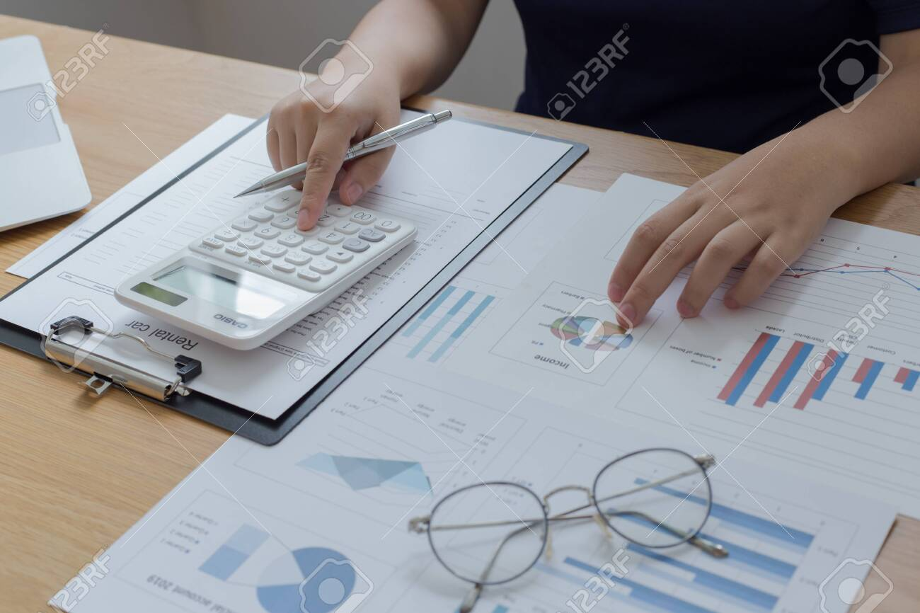 The young accountant is checking the money of a reputable national financial organization in a country. - 142958668