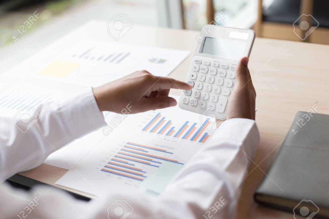 The professional investor, businessman Executives are working and analyzing project statistics result in report investment and planning strategic marketing, financial and accounting concept - 143402279