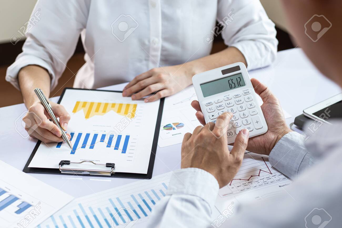 The team leader and the company's finance department are meeting and analyze the market data with a bar chart, Financial management for tax and accounting systems concept. - 144095191