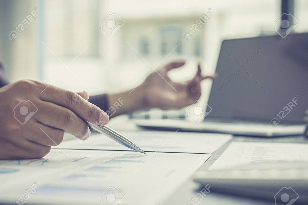 Independent financial businessmen calculate the client's annual income and analyze the market in-depth with office graphs, Income Tax Management and Financial Accounting concept. - 149986900