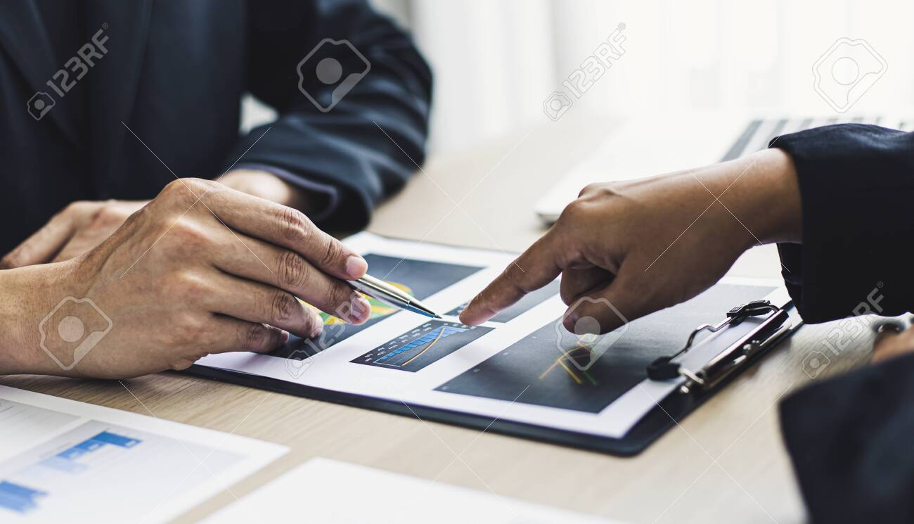 Meeting a team of businessmen, Executives and accountants meeting about the company's revenue graph in the office with laptops and calculators, Finance concept. - 156930438
