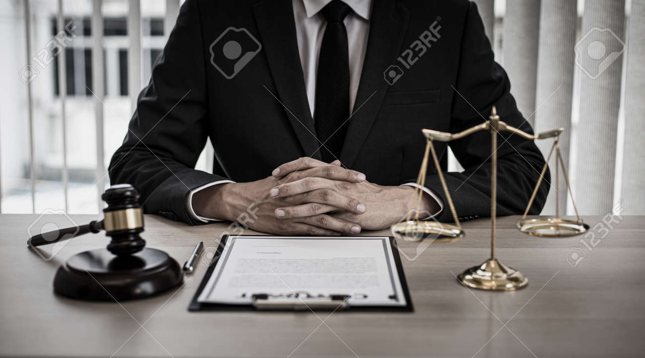 Judge or a lawyer works documents in the courtroom and analyze the various laws for justice and accuracy, Litigation and justice concept. - 157100843