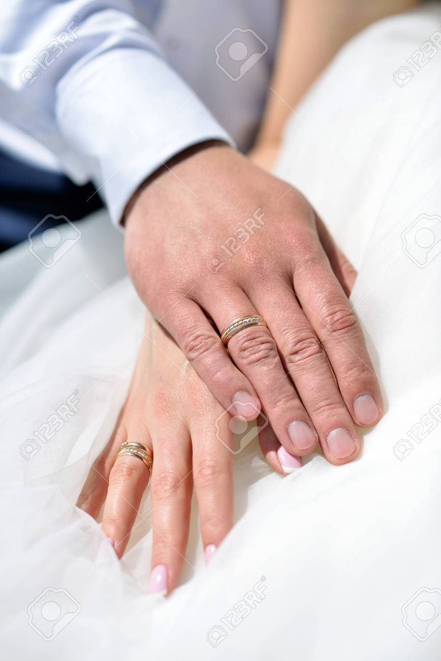 Wedding Couple Is Holding Hands. Beauty Bride With Groom. Beautiful ...