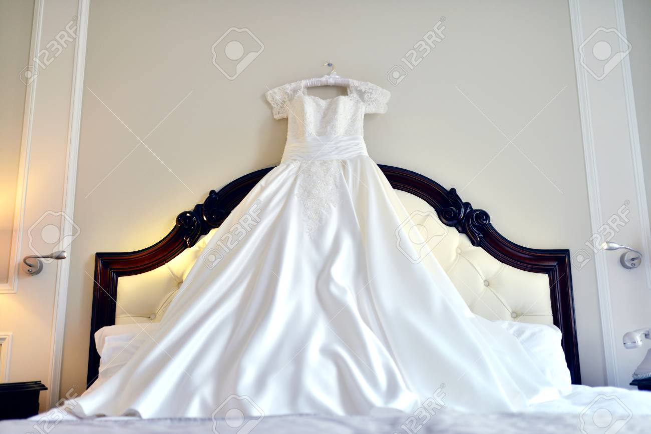 Beautiful White Wedding Dress For Bride Indoors On The Bed. Beauty ...