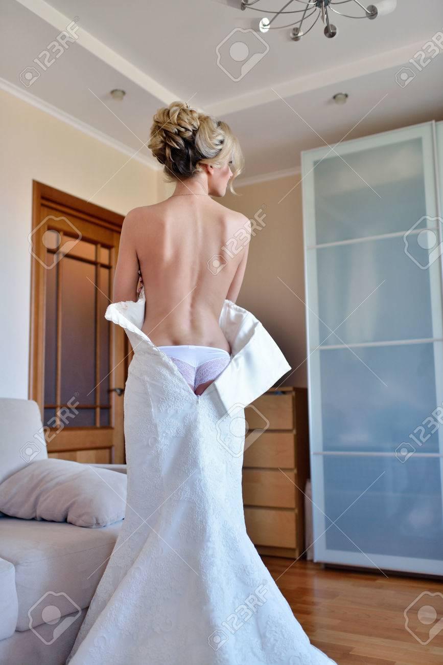Beautiful Bride In Lingerie Is Wearing A Wedding Dress Beauty