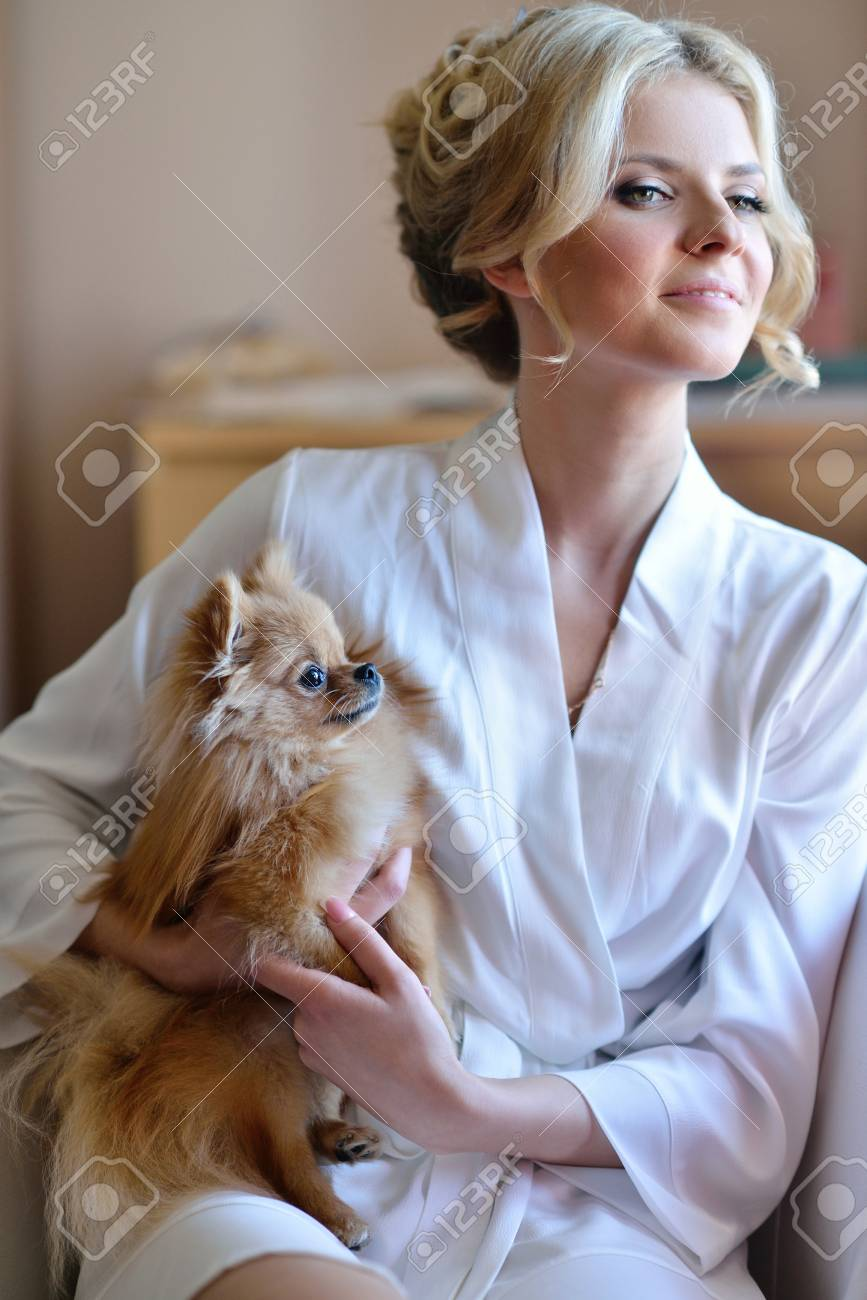Beauty Bride In Dressing Gown With A Cute Dog Indoors. Beautiful ...