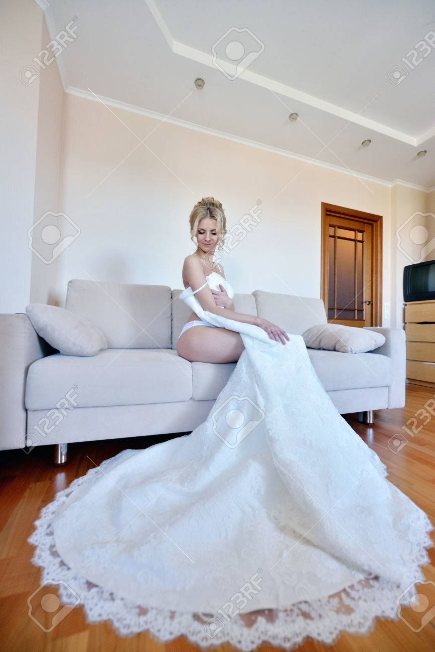 Beautiful Bride In Lingerie Is Wearing A Wedding Dress. Beauty ...