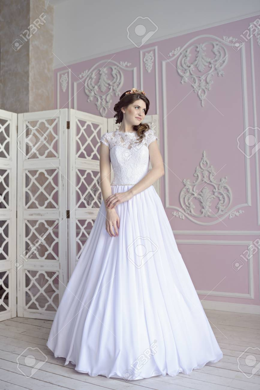 Beauty Bride In Bridal Gown Indoors. Beautiful Model Girl In.. Stock ...