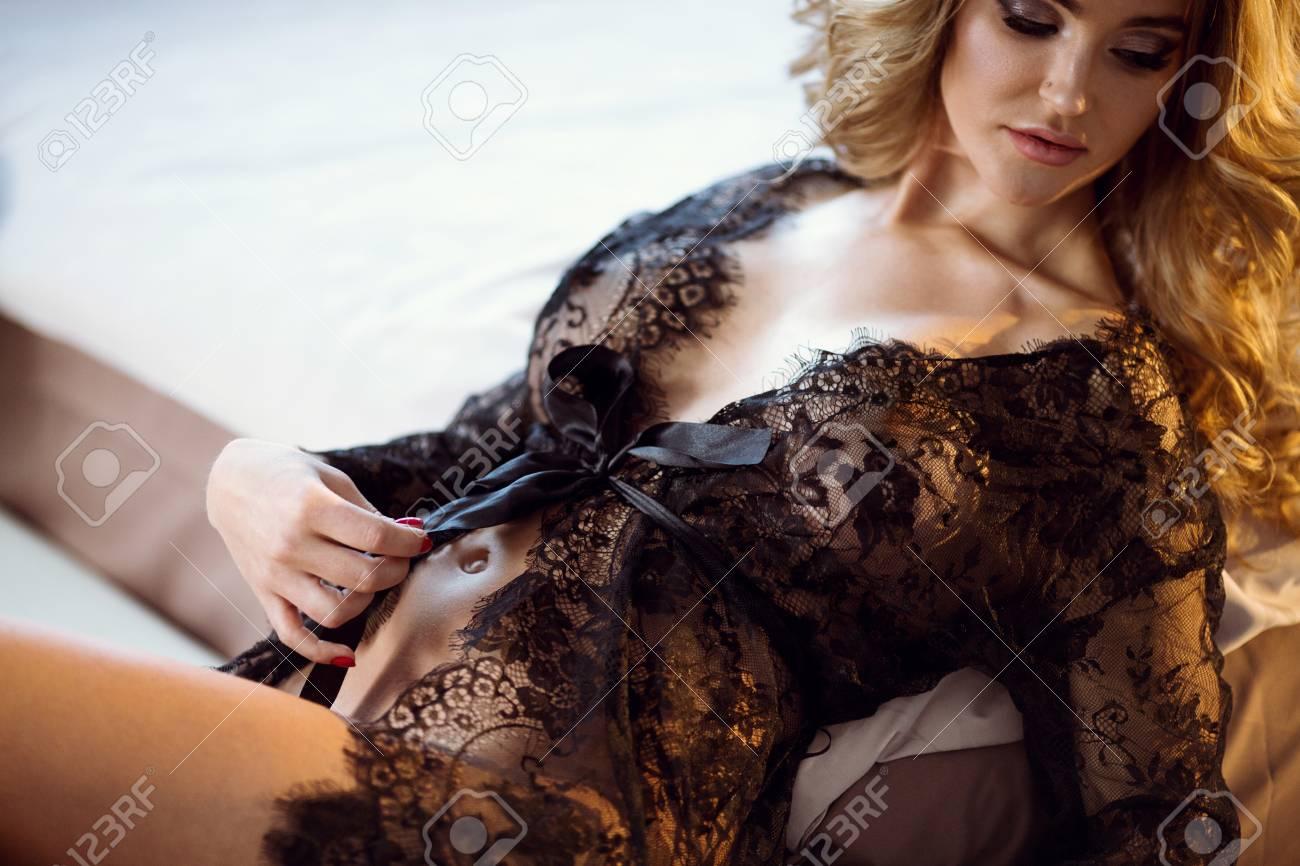 Beautiful lady in elegant black robe - 100124566