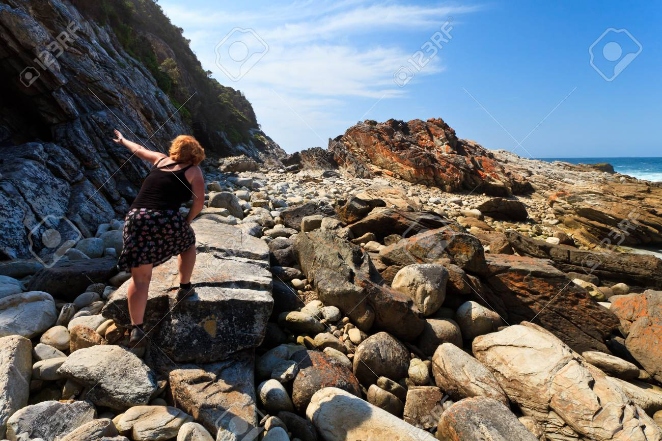 Woman hiking along the Rocky dangerous coastline Stock Photo - 12577154