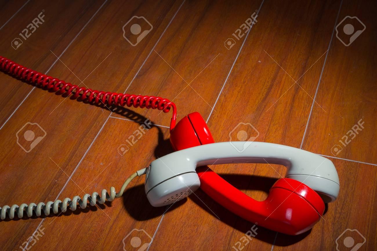 Old vintage phone handsets on wood Stock Photo - 20342487