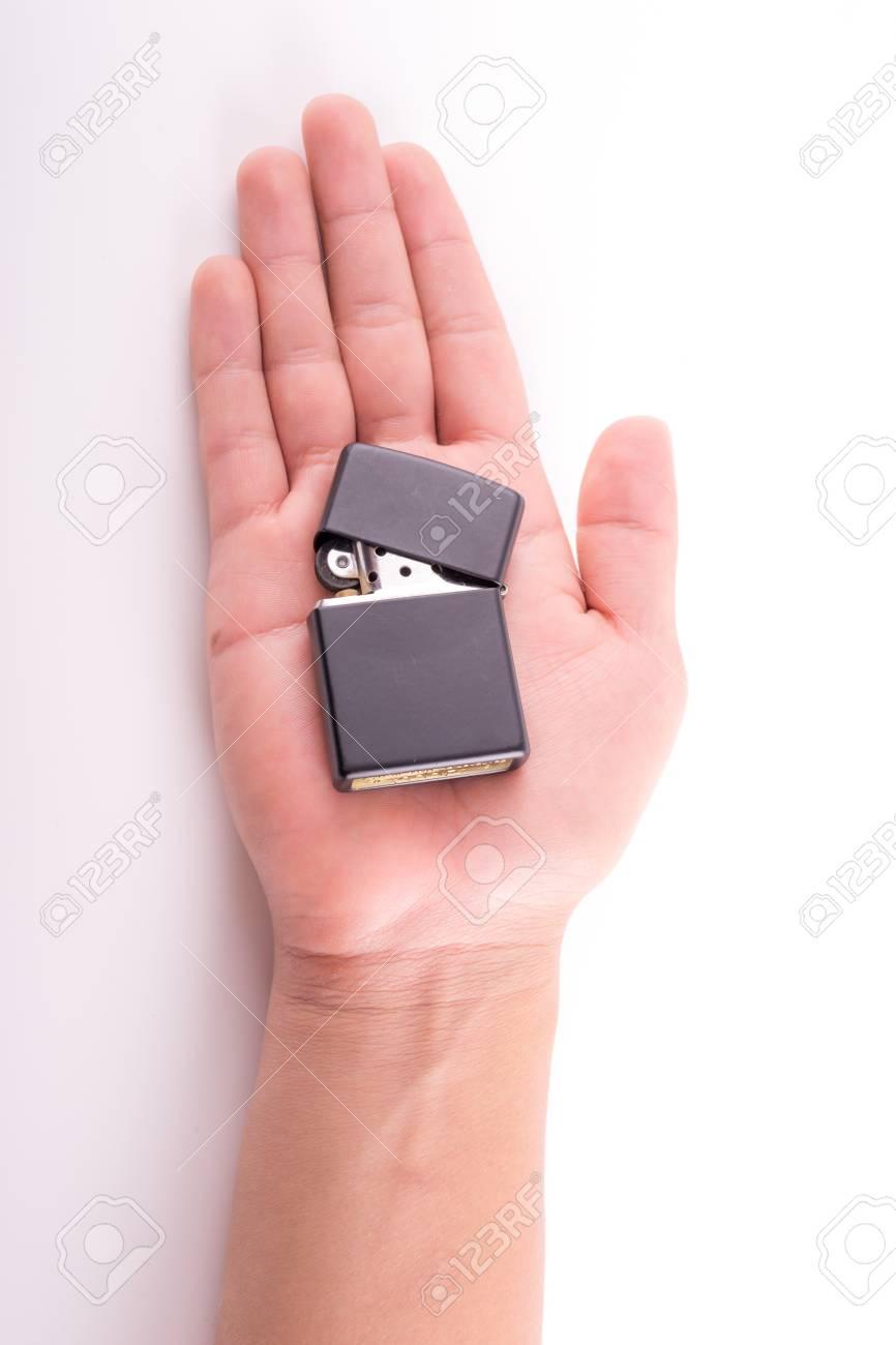 Hand hold  holding lighter, on white background Stock Photo - 21279983