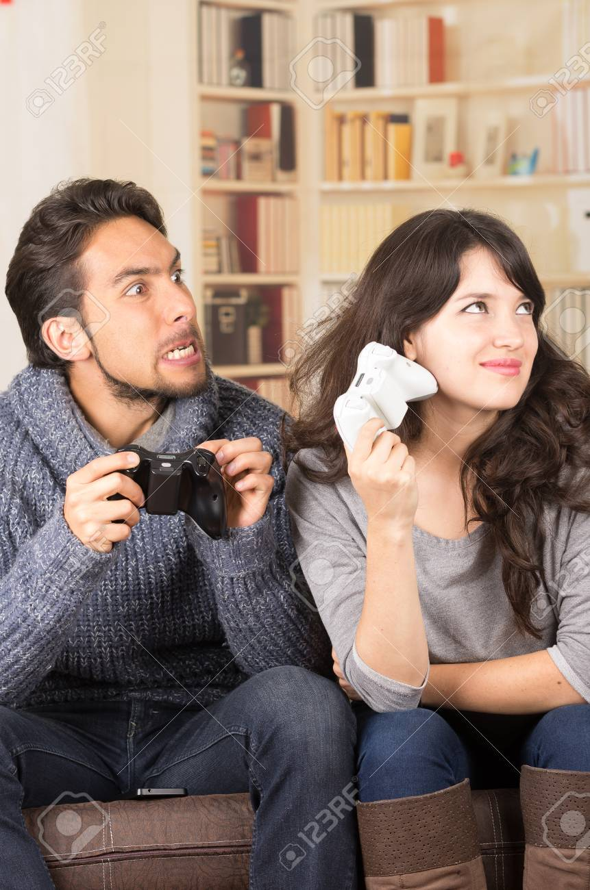 Young Cute Playful Couple Playing Video Games In Livingroom Stock Photo Picture And Royalty Free Image Image 34313079