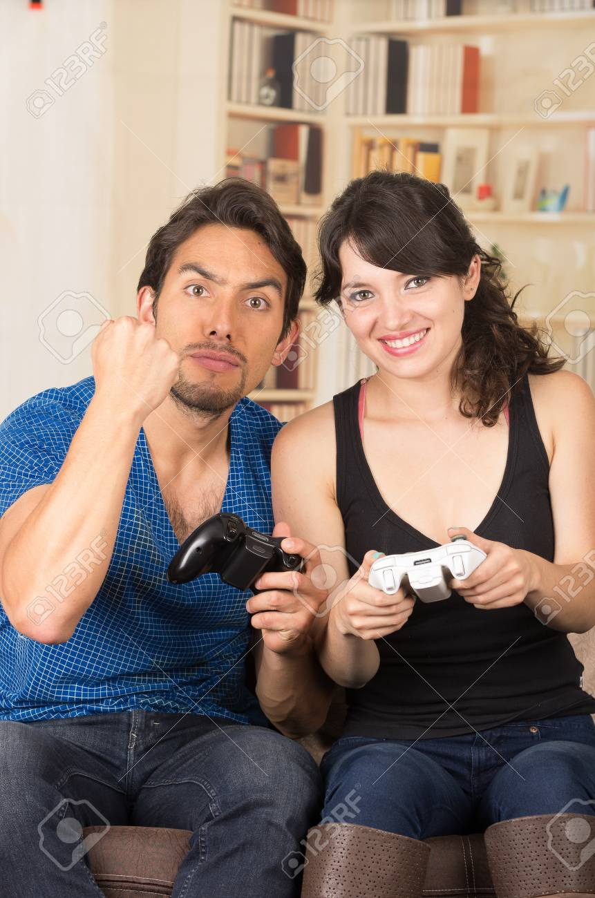 Young Cute Competitive Couple Playing Video Games In Livingroom Stock Photo Picture And Royalty Free Image Image 34735409
