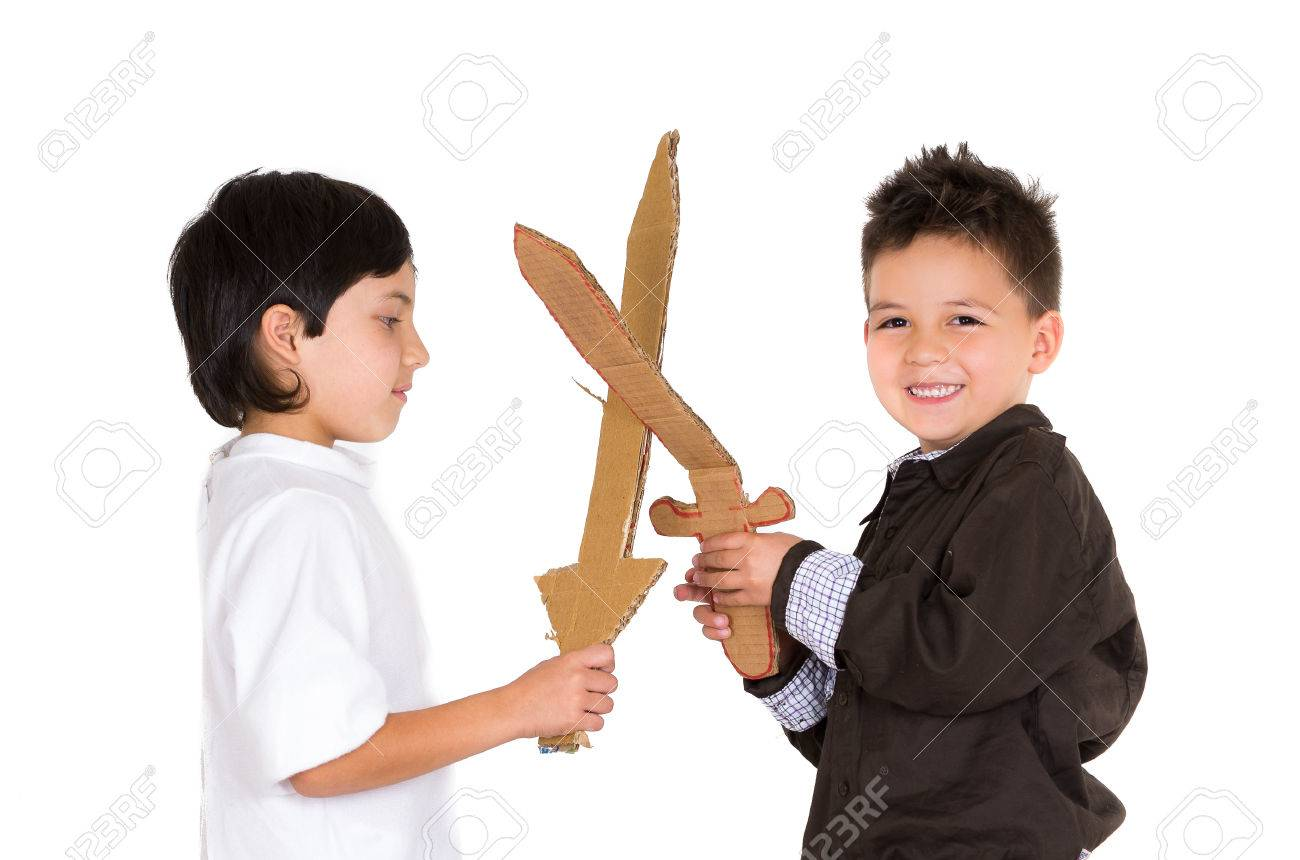 Two Small Boys Simluating Sword Fight Using Toys And Homemade Shield White Background Stock