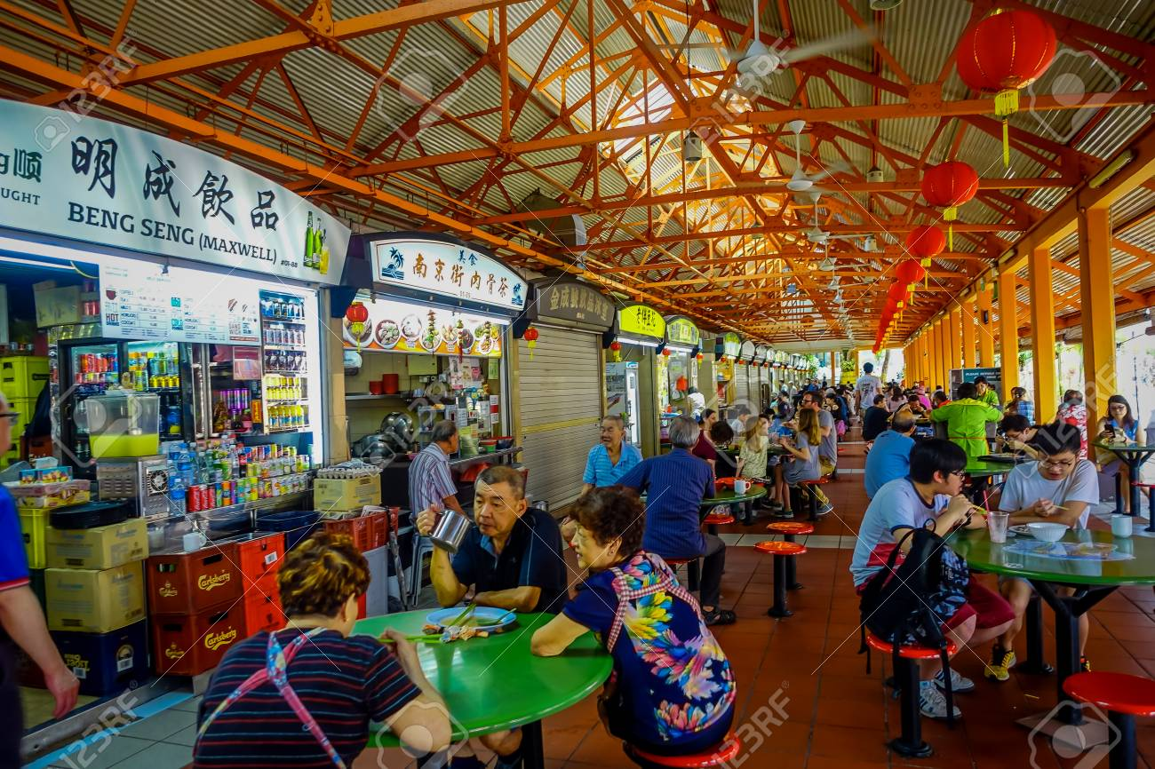 SINGAPORE, SINGAPORE - JANUARY 30. 2018: Unidentified people eating in The Lau Pa Sat festival market Telok Ayer is a historic Victorian cast-iron market building now used as a popular food court hawker center in Singapore - 96024313