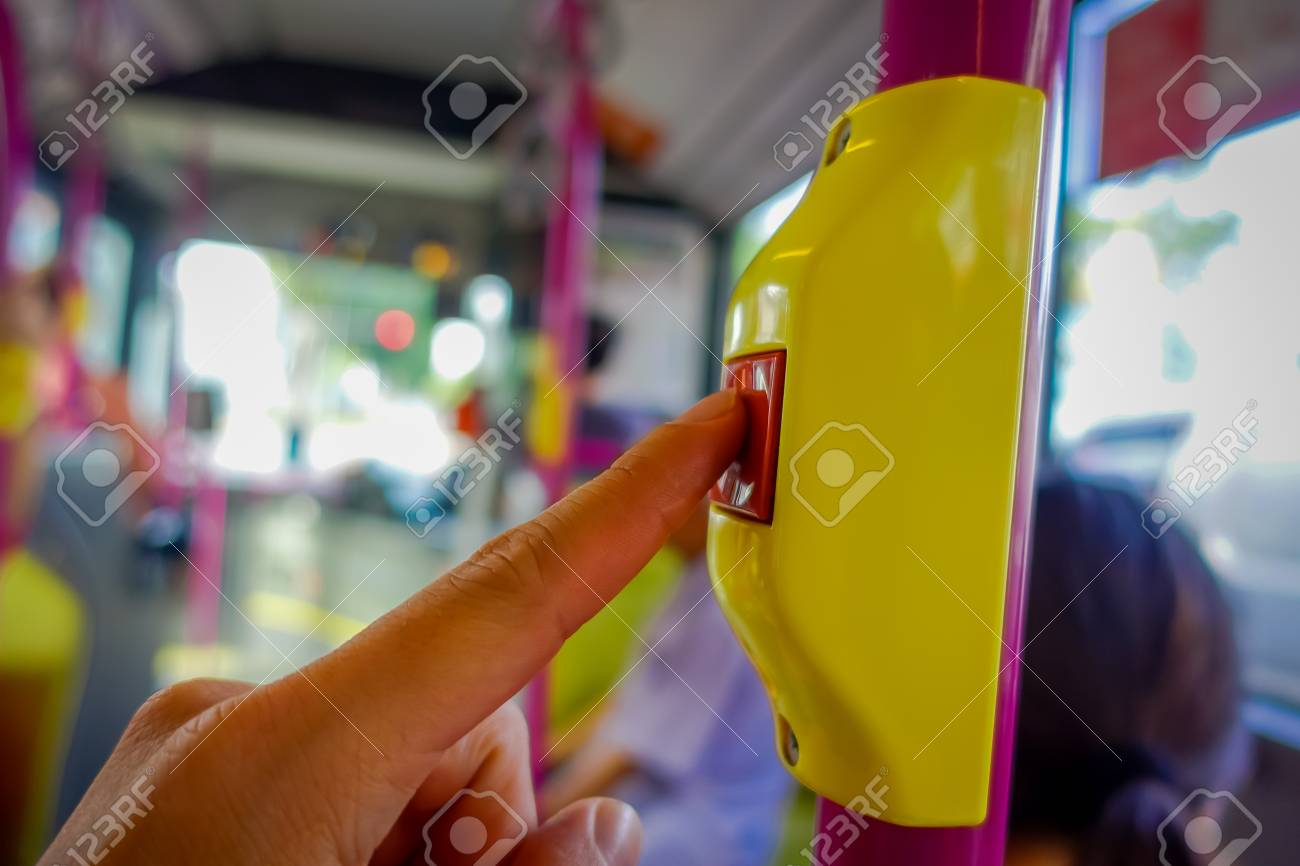 Close up of selective focus of a hand pushing a bus Stop Button