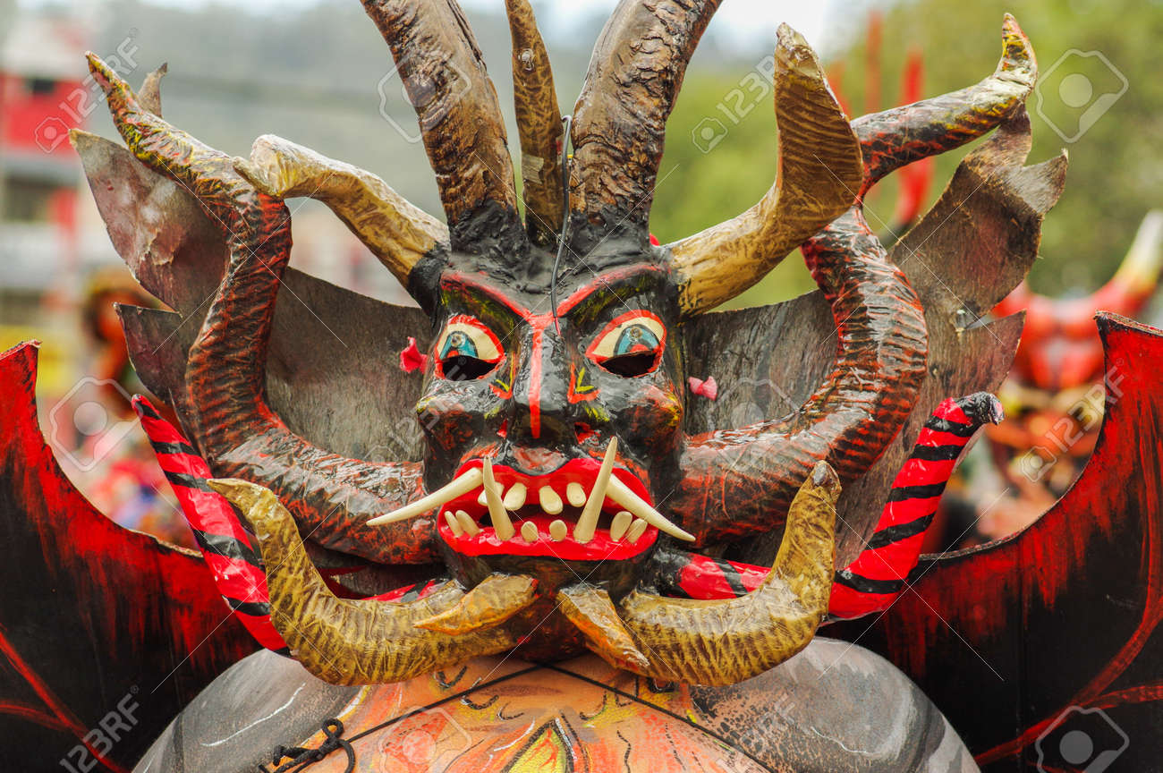 Quito, Ecuador - September, 03, 2018: Portrait of unidentified man dressed up and participating in the Diablada, popular town celebrations with people dressed as devils dancing in the streets - 120107218