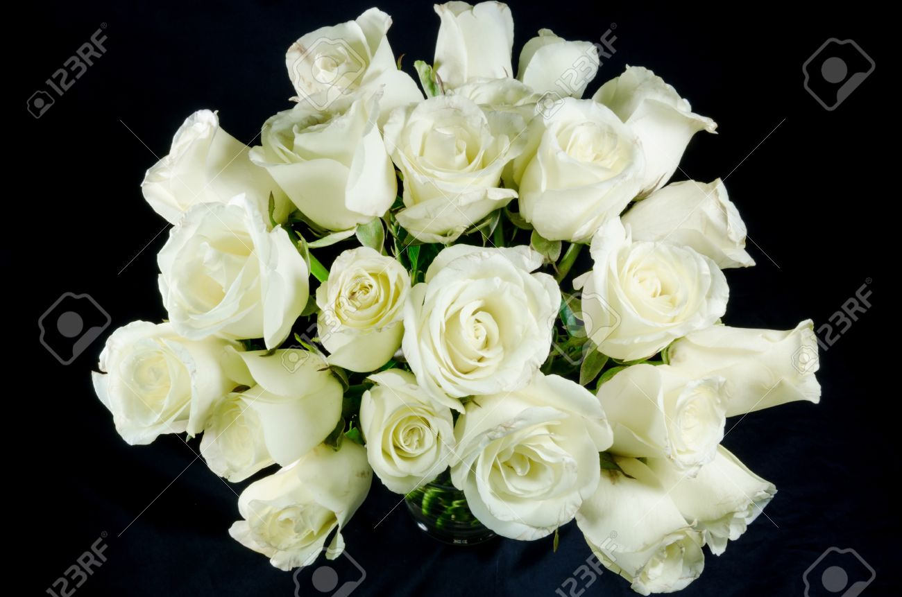 White roses bouquet on black background stock photo picture and stock photo white roses bouquet on black background izmirmasajfo