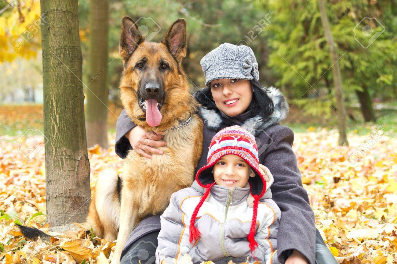 Mom son and faithful friend the dog Stock Photo - 14599603
