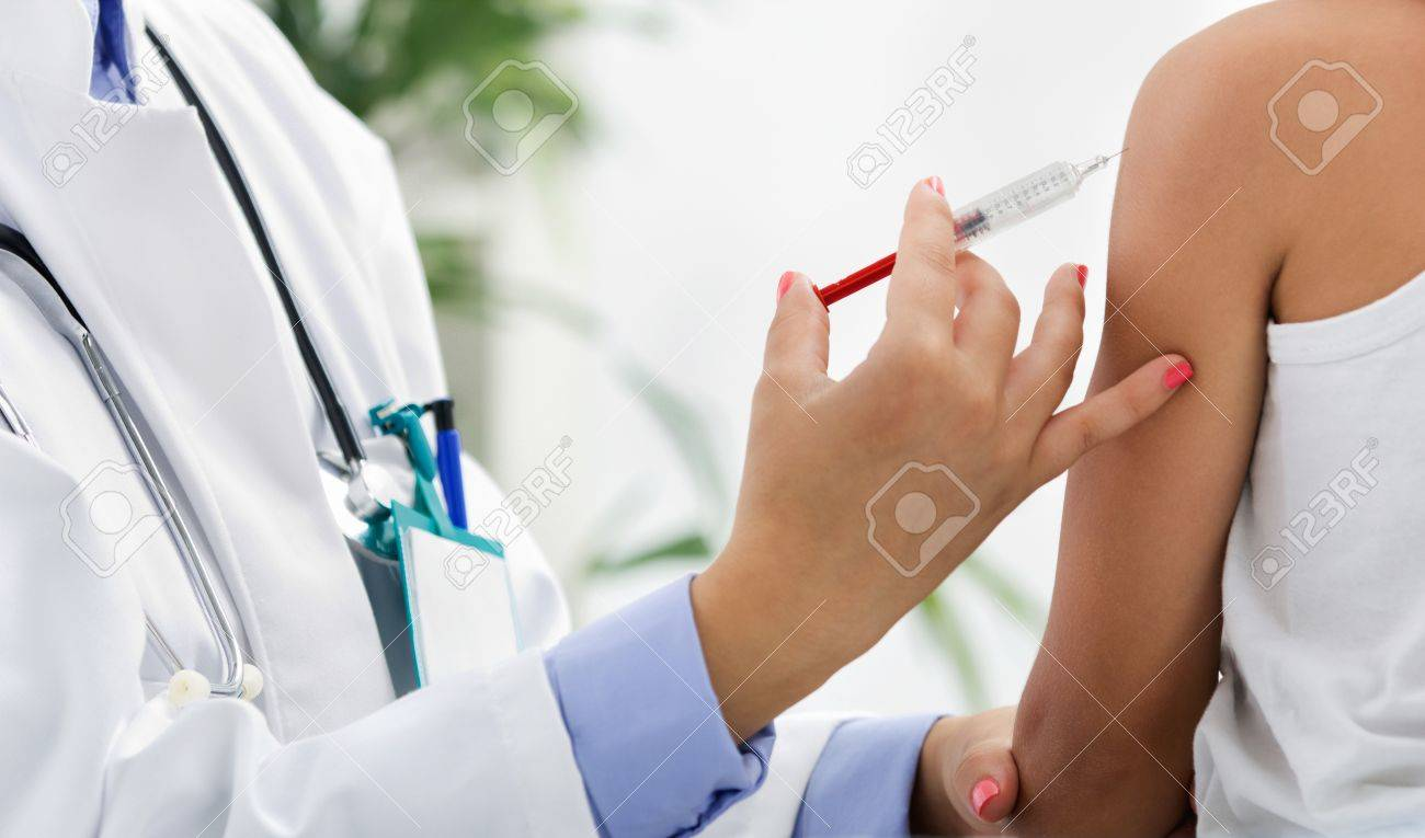 doctor making vaccination to the patient - 20705703