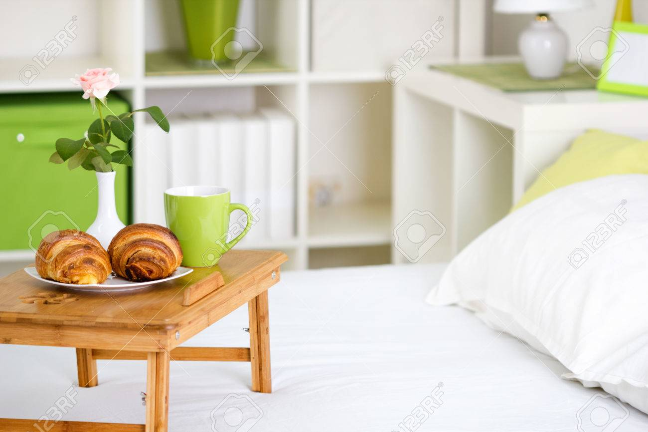 breakfast in bed with pastries on a tray  and a rose in the vase Stock Photo - 22742708