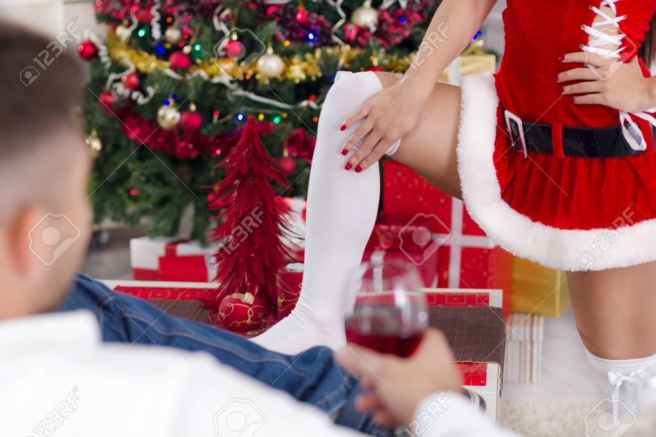 female Santa seduces man on Christmas Eve - 22933976