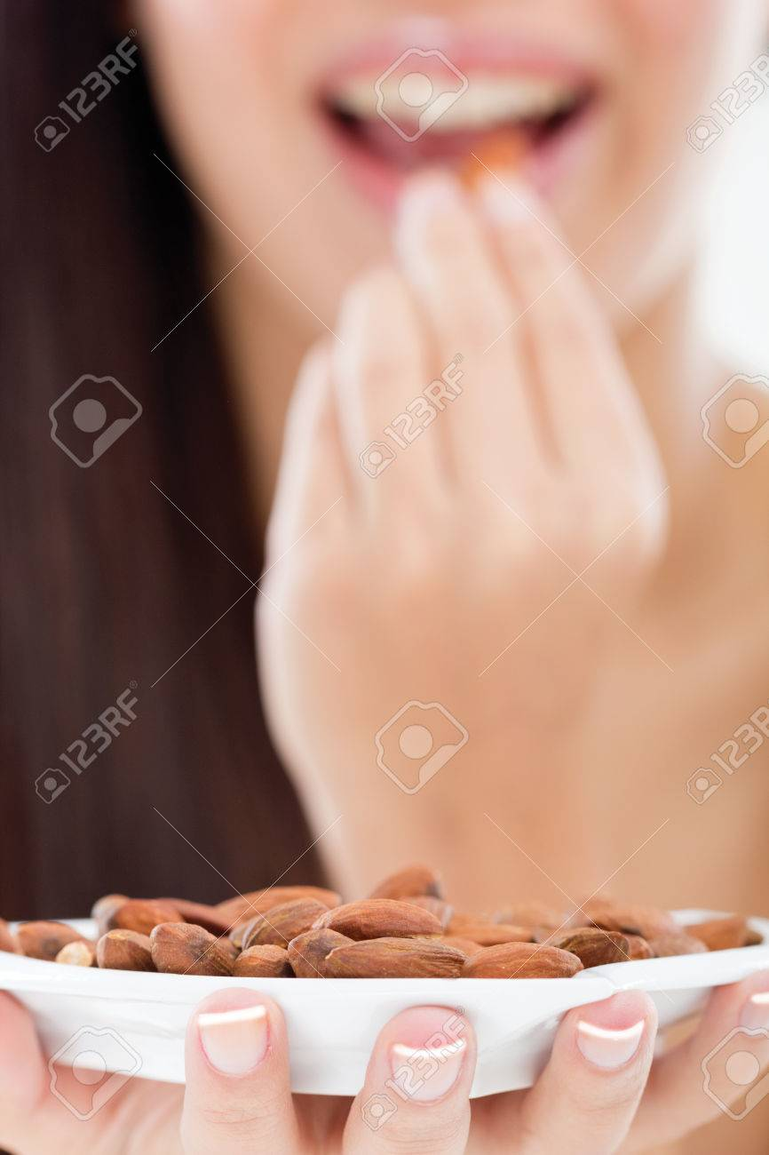 woman holding a bowl of almonds - 24365328
