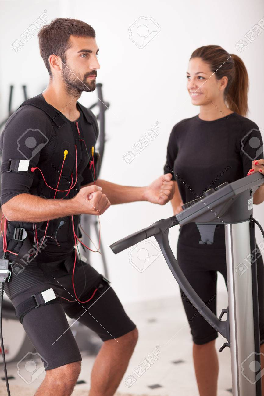 man exercise, with ems muscular stimulation - 31941099
