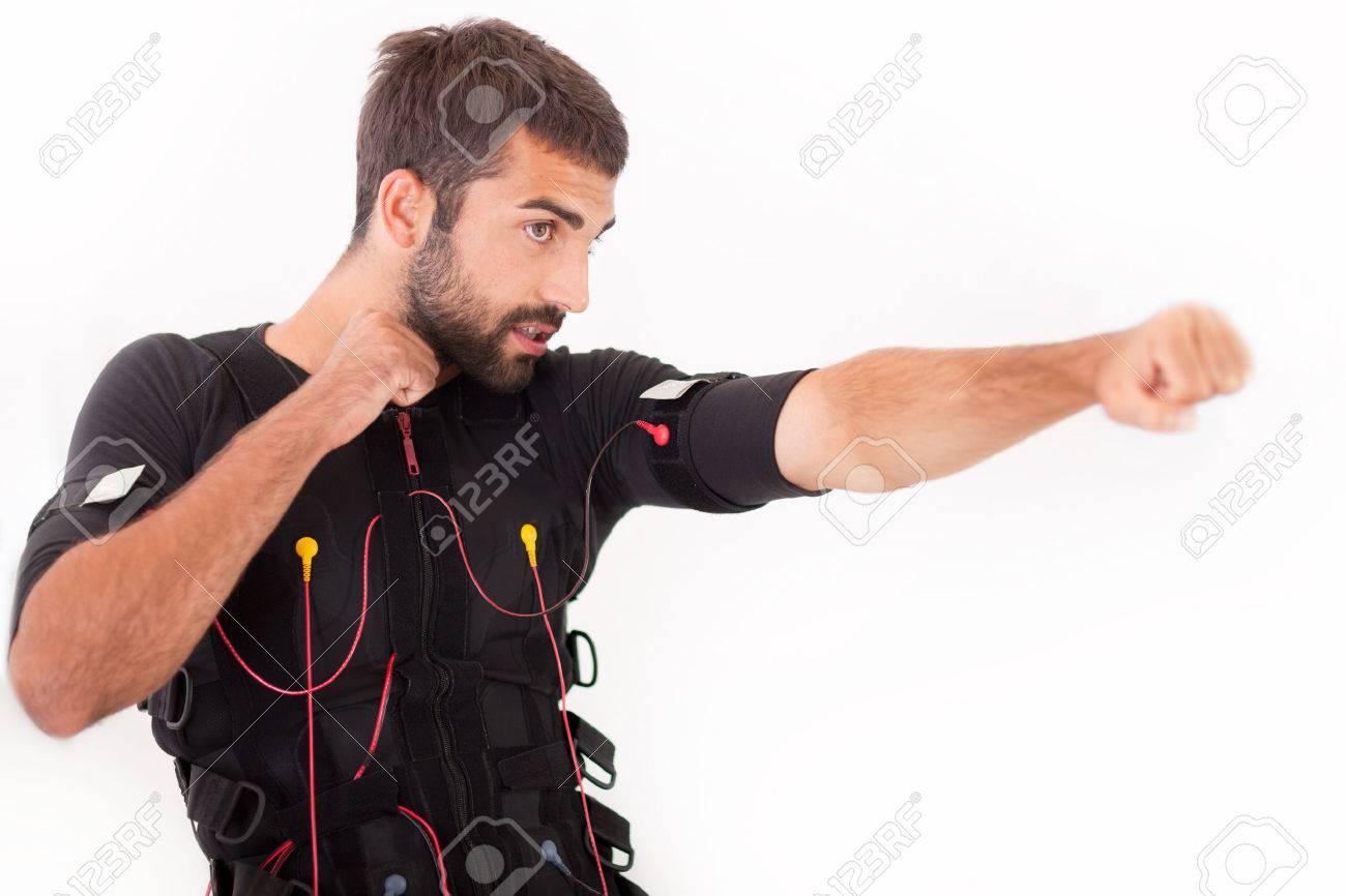 man working on electro muscular stimulation machine - 31941103