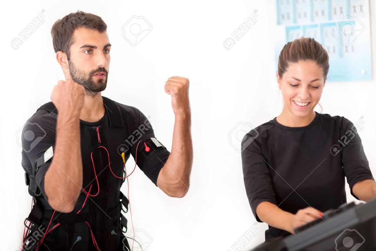man exercise with ems stimulation - 33331609