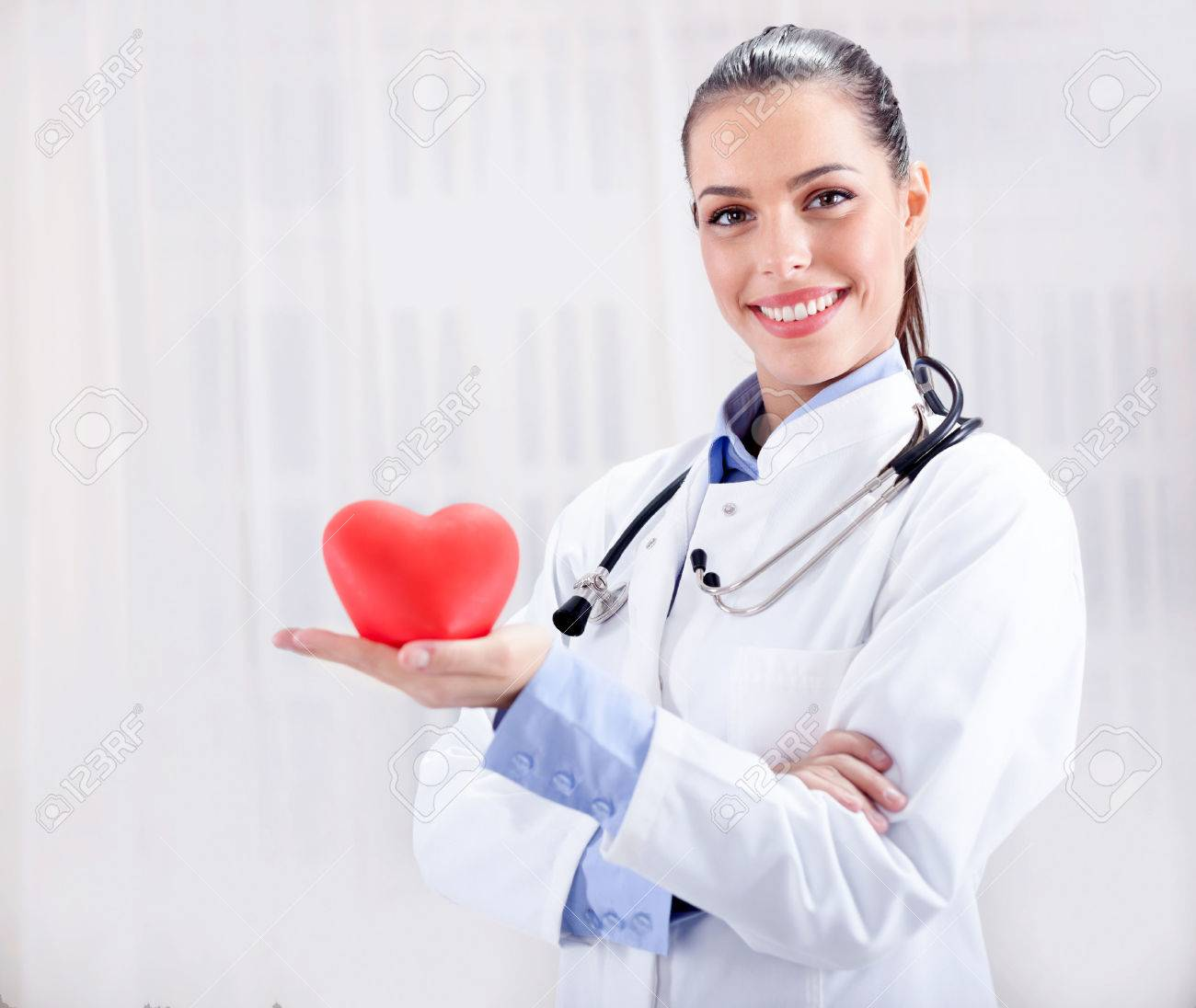 healthcare and medicine concept - smiling female doctor with heart and stethoscope - 35448965
