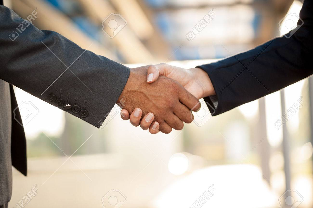 hand business men and women who shaking hands - 47233641