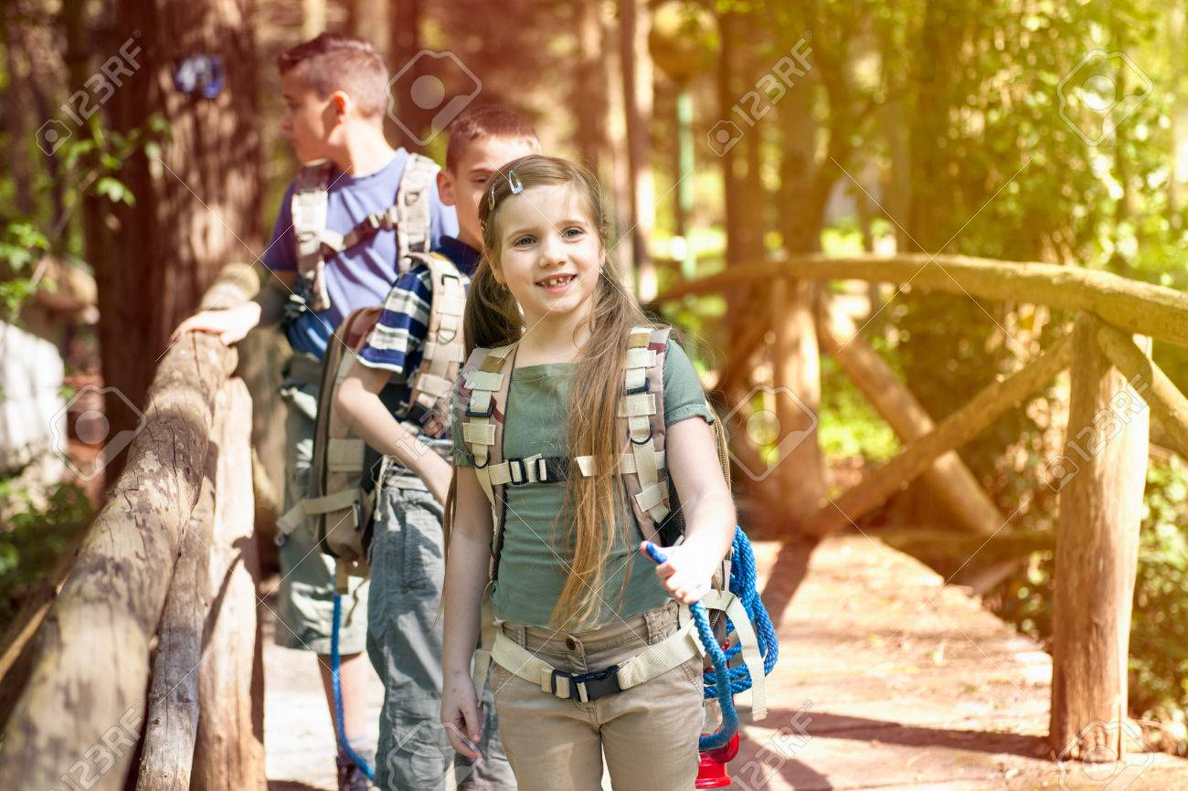 kids in green forest playing,concept of kids vacations and travel - 76070456