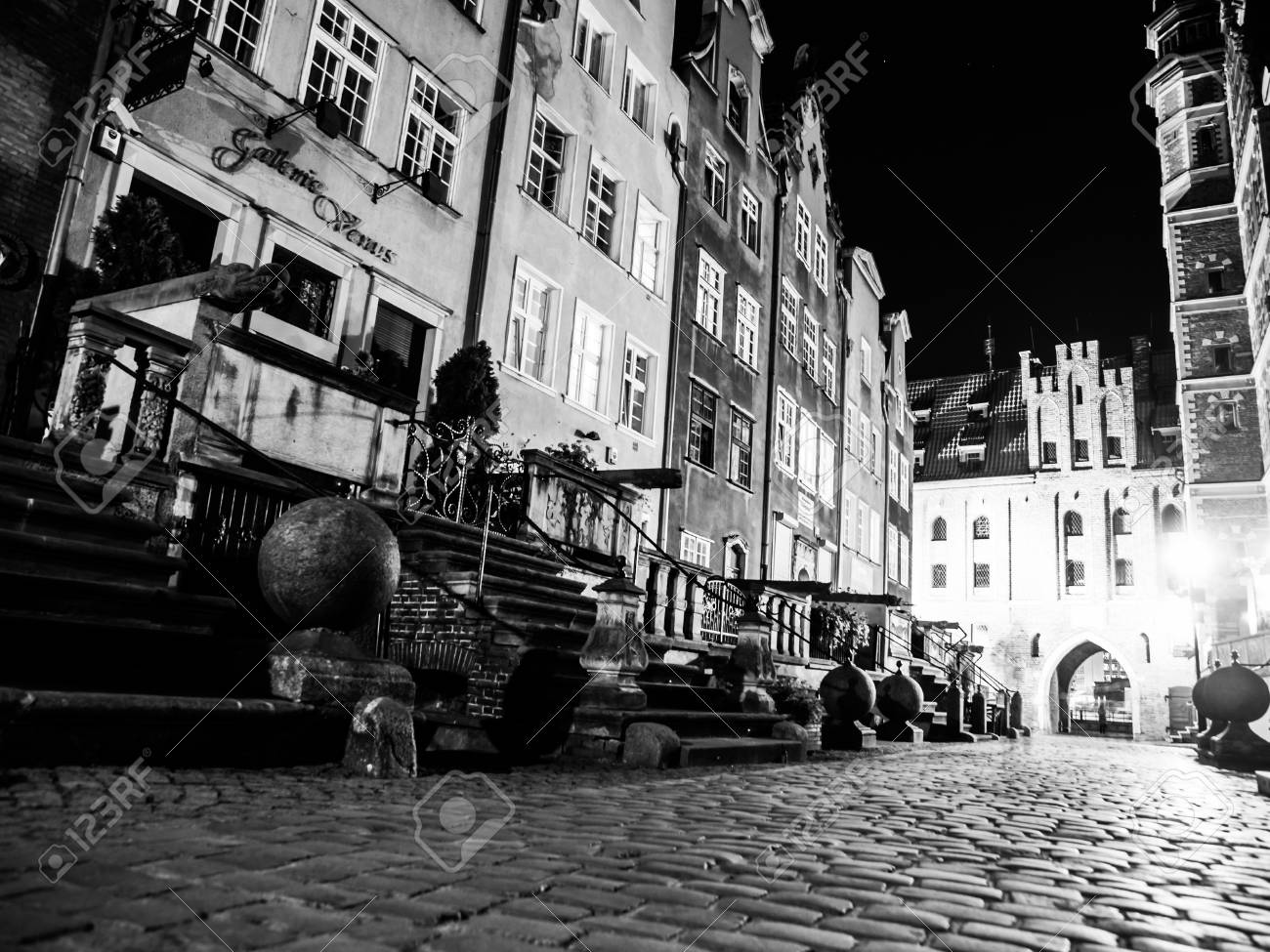 Mariacka street by night in old town of gdansk poland black and white image