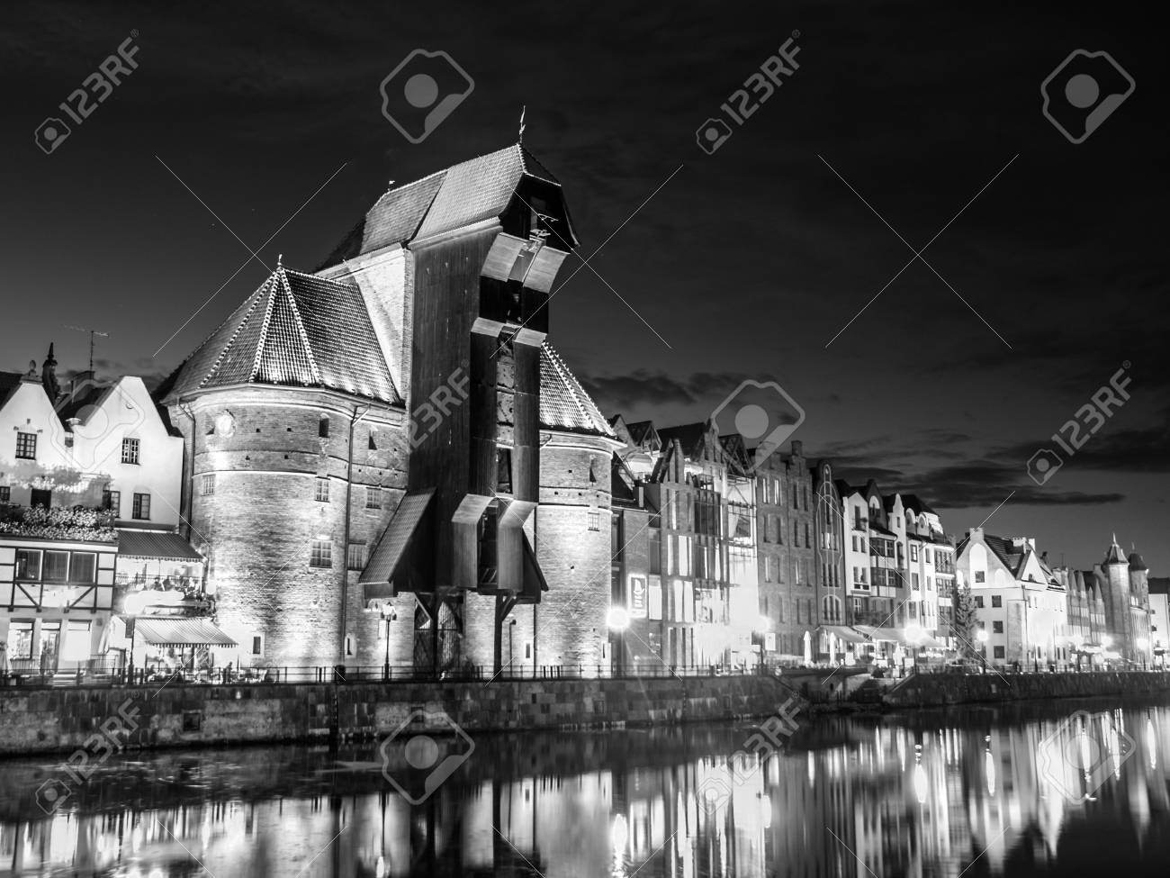 Gdansk by night with old crane and reflection in motlawa river poland black and