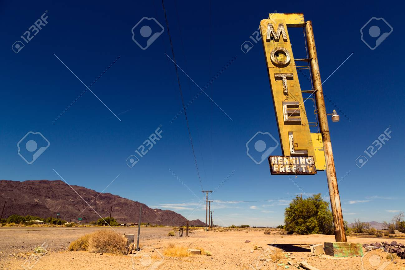 Vintage rusty motel sign on Route 66 in American desert land - 97073026