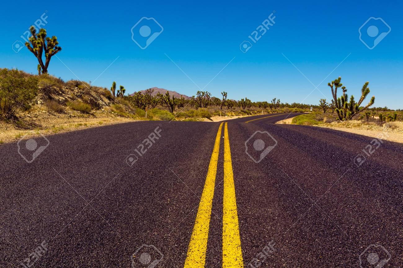 Famous Route 66 going through Mojave Desert in California - 97073027
