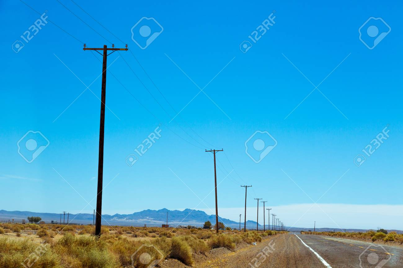 Neglected part of Route 66 in American desert land in California - 97073028