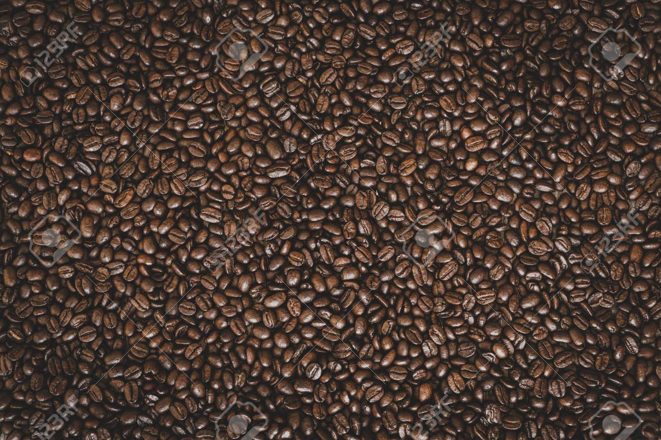 Rich brown roasted coffee beans background - 97431638